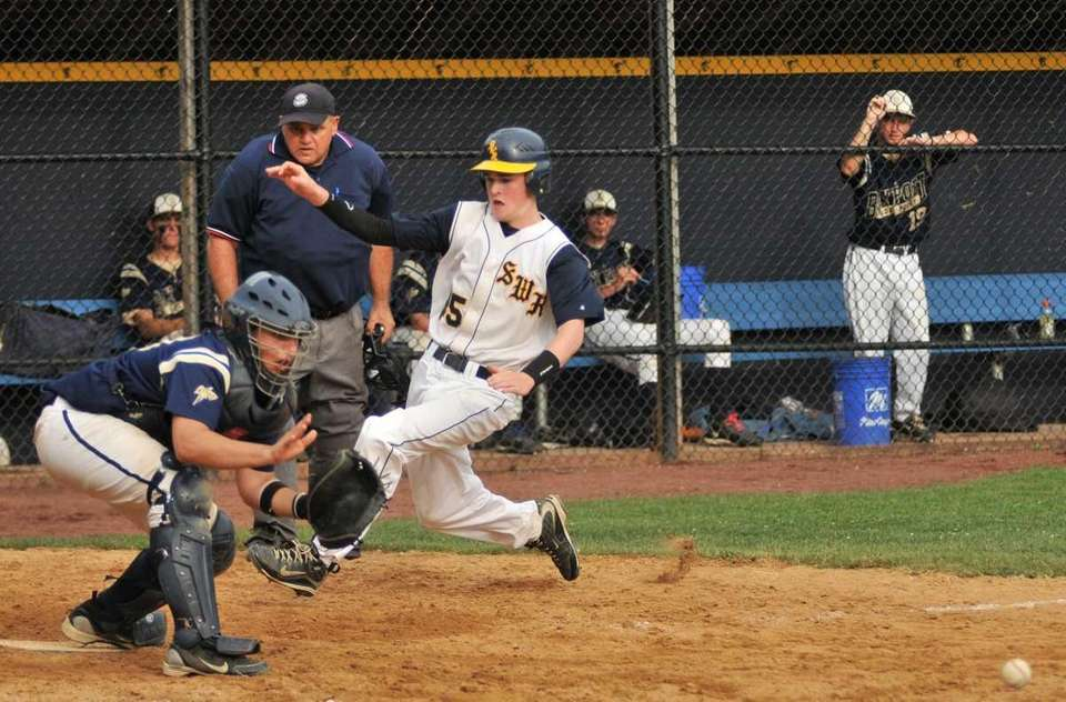 Shoreham-Wading River pinch runner Sean Logan (45) heads