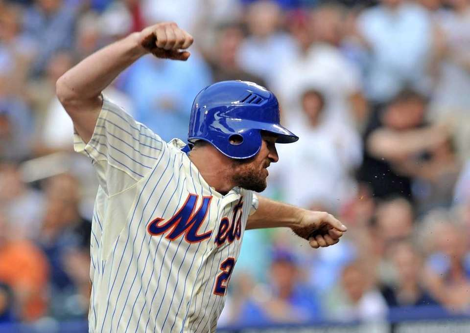 Daniel Murphy is excited after scoring on David