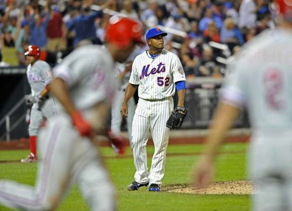 Ramon Ramirez of the Mets watches Jimmy Rollins'