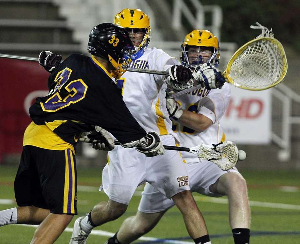 Sayville's Jake Sichenzia (33) puts a shot past