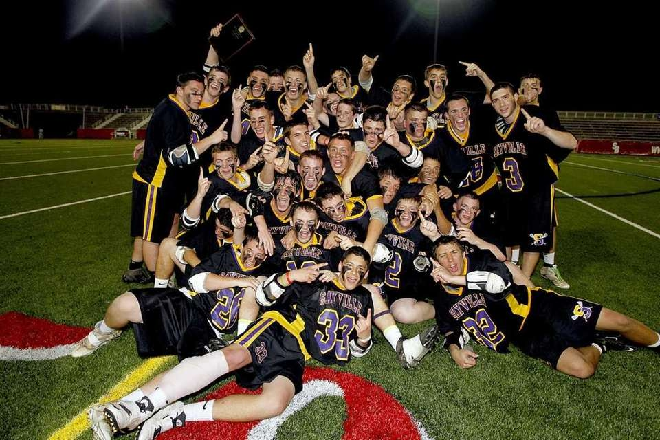 The Sayville boys lacrosse team celebrates its victory