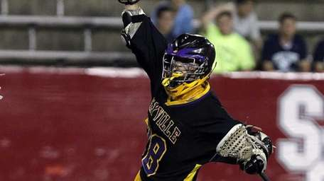 Sayville's Dan Koehler (28) celebrates a score in