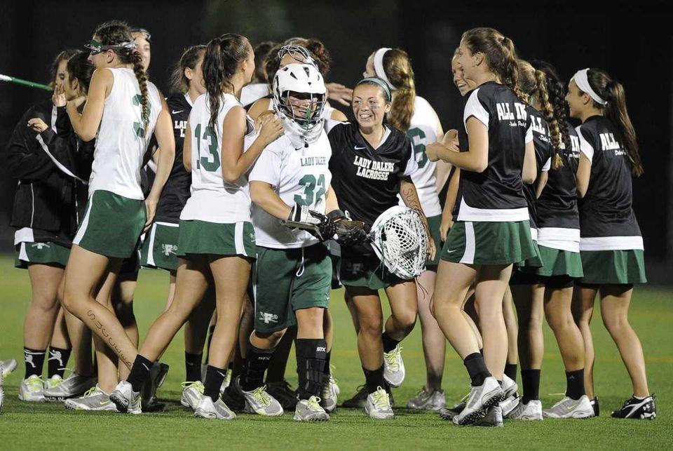 Farmingdale team members mobs their goalkeeper Olivia Kirk
