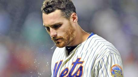 Daniel Murphy walks to the dugout at the