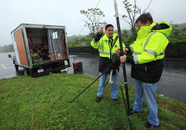 U.S. Geological Service hydrologists Anthony Chu, left and