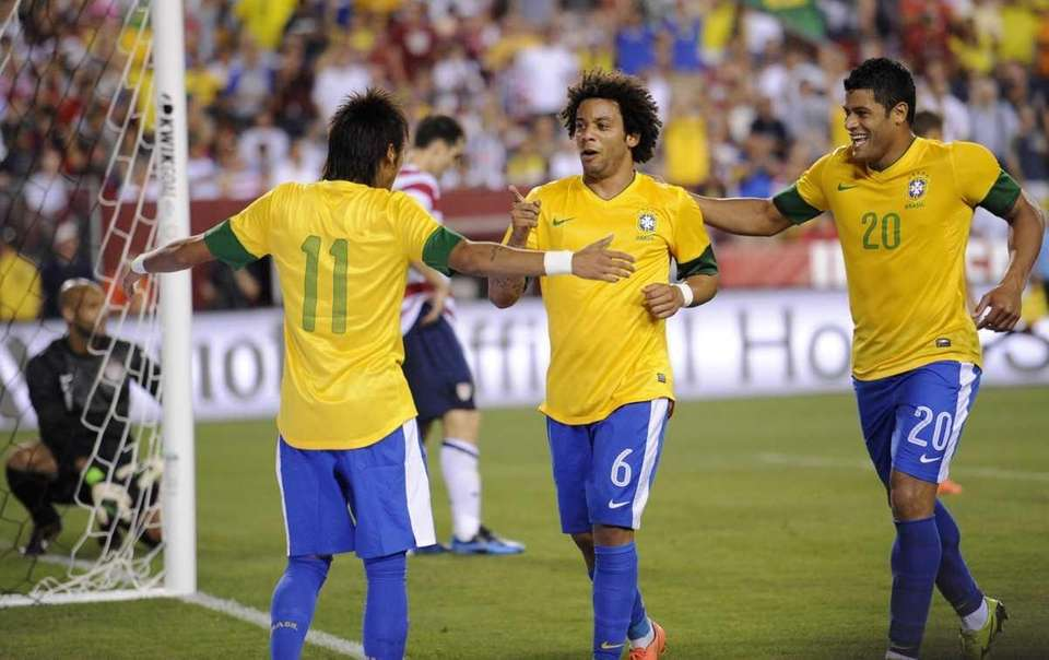 Brazil's Marcelo (6) celebrates his goal with Neymar