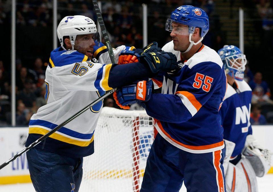 Johnny Boychuk of the New York Islanders battles