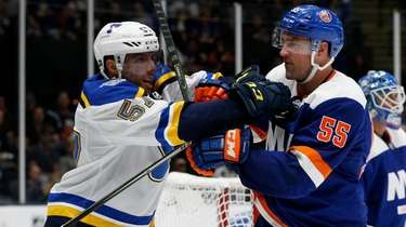 Johnny Boychuk of the New York Islanders battles