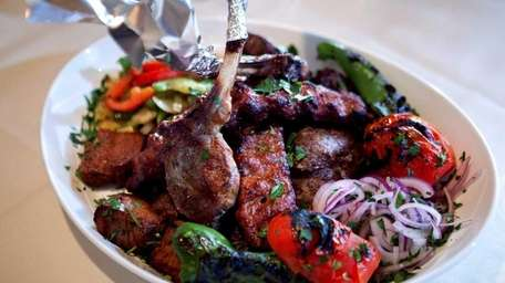 Pita House's mixed kebab platter is served with