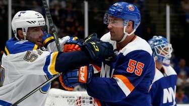 Johnny Boychuk of the Islanders battles for position