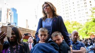 Lisa Tuozzolo and her sons, Austin, left, and