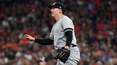 Yankees relief pitcher Chad Green reacts to the