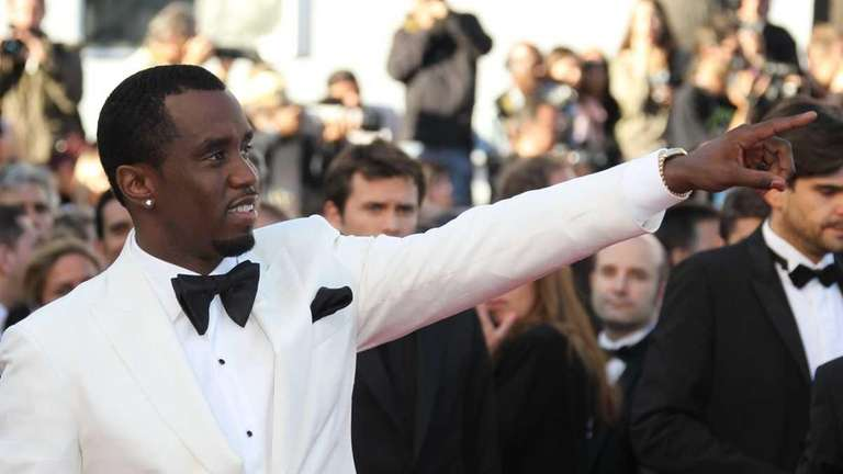 Sean Combs arrives for the screening of