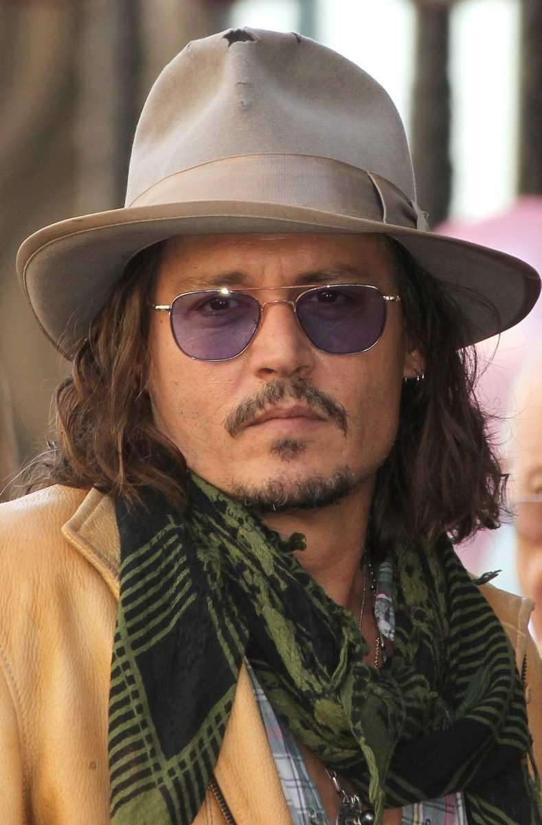 Signature blue glasses are a Depp fave, along