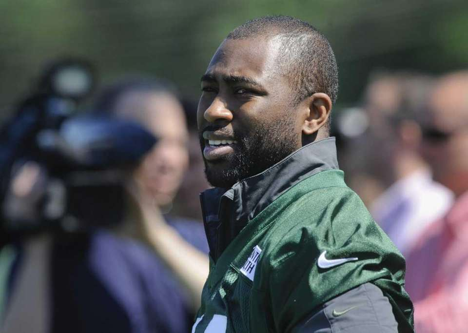 Jets cornerback Darrelle Revis watches the offense during