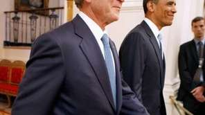 Former U.S. President George W. Bush, left, and