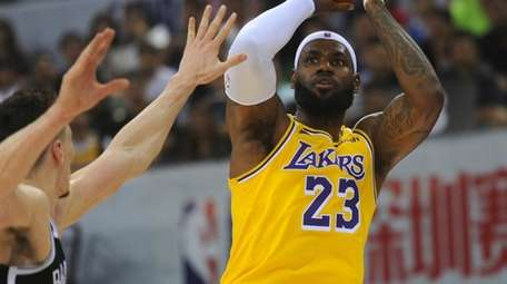 The Lakers' LeBron James shoots during an NBA