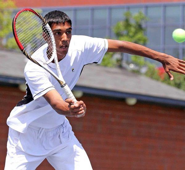 Herrick's Vihar Shah hits a forehand during his