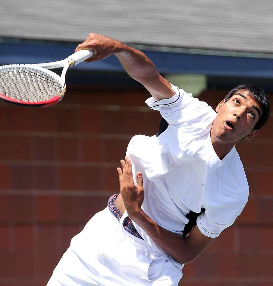 Herrick's Vihar Shah serves against South Hampton's Jeremy