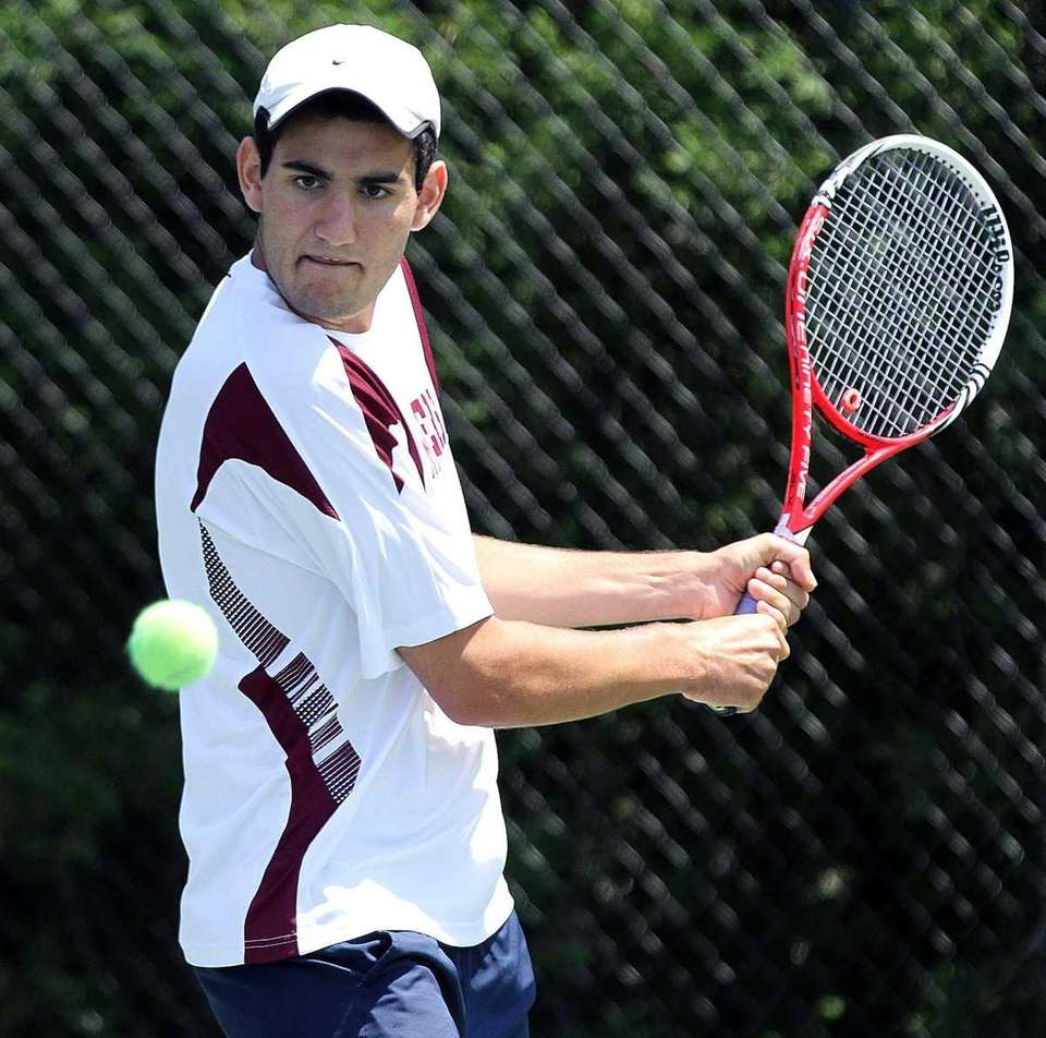 South Hampton's Jeremy Dubin takes a backhand against