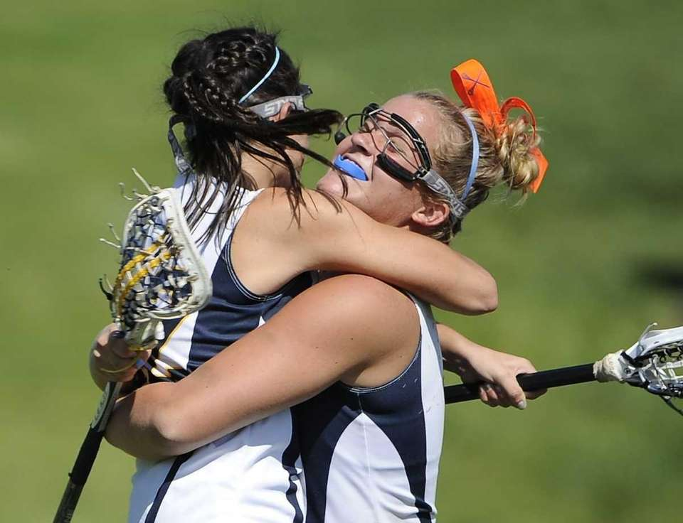 Shoreham-Wading River's Katie Boden, right, and Alyssa Pearce,