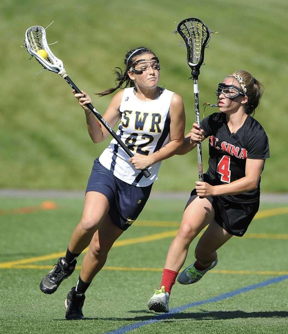 Shoreham-Wading River's Alyssa Pearce is defended by Mt.