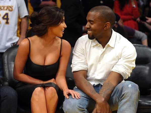 Kim Kardashian and Kanye West courtside at a