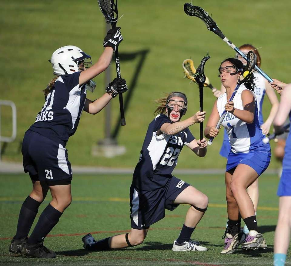 Hauppauge's Taylor Ranftle scores against Eastport-South Manor goalkeeper