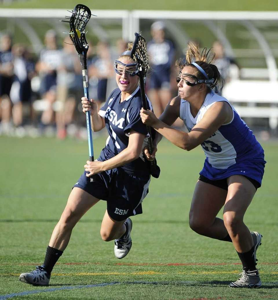Eastport-South Manor's Dakota Mason drives around a Hauppauge
