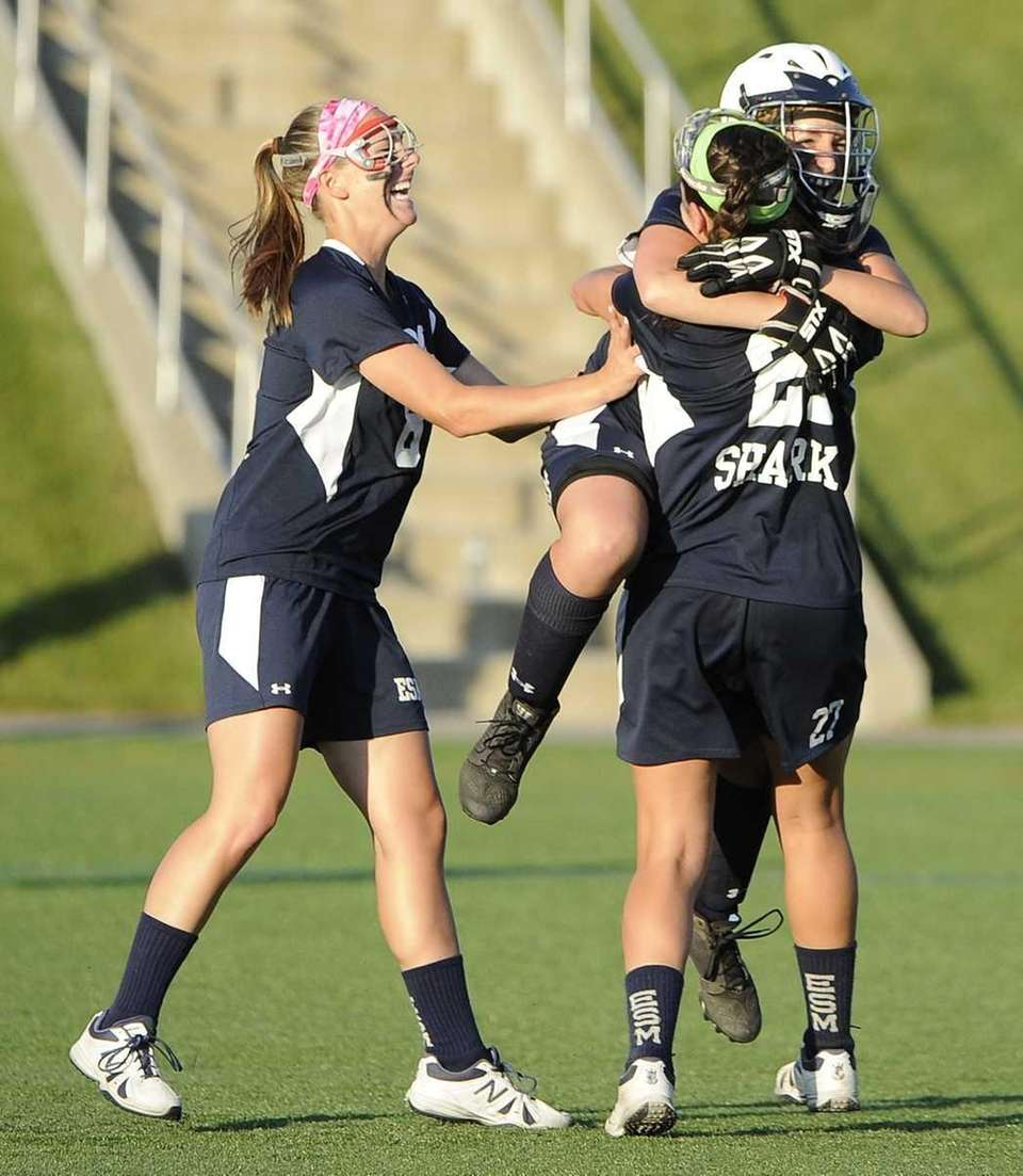 Eastport-South Manor teammates celebrate their win over Hauppauge