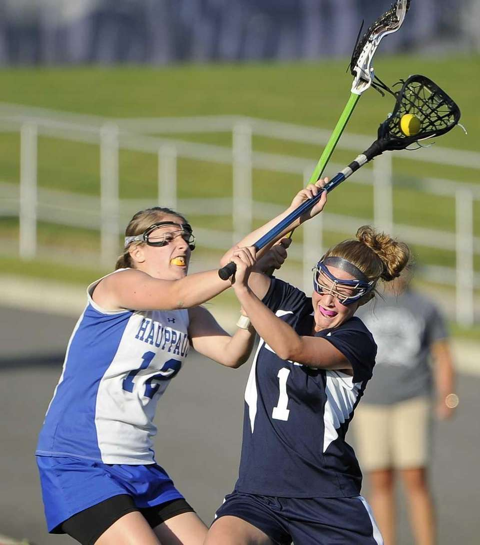 Eastport-South Manor's Dakota Mason shoots and scores past