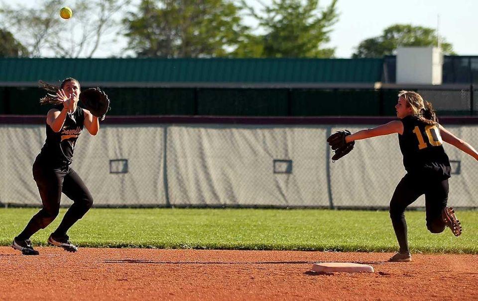 Sayville shortstop Emily Sellitti fields the ball during