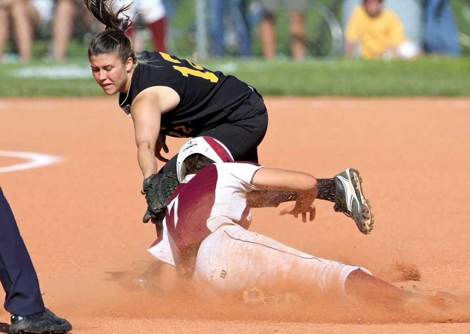 East Hampton's Kathryn Hess slides under the tag