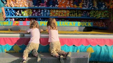 Twins Bridget and Keely Dwyer, 4, of Floral