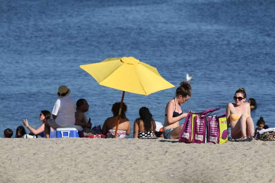 Residents enjoy the warm weather on Oakland Beach