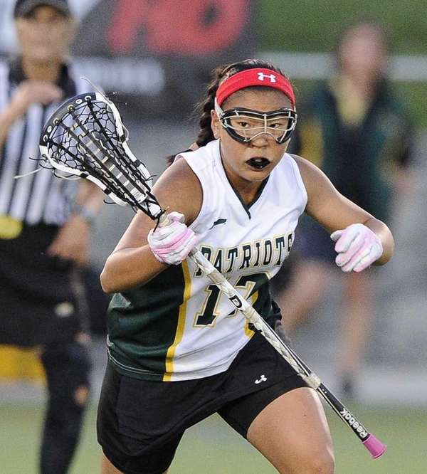 Ward Melville's Yuna Hur rushes for a ground