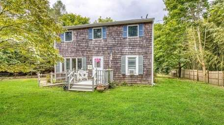 This Center Moriches home is listed for an