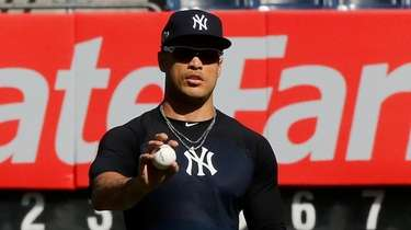 Giancarlo Stanton of the New York Yankees warms
