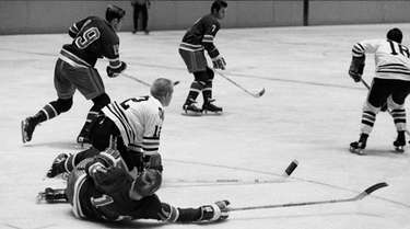 Chicago Blackhawks' Pat Stapleton sprawls after the puck