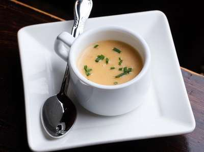 A Lobster bisque served in a petit cup