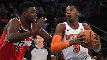 The Knicks' RJ Barrett drives to the basket