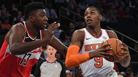 The Knicks' RJ Barrett drives to the basket