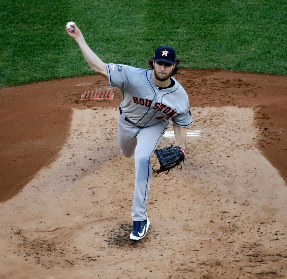Houston Astros starting pitcher Gerrit Cole (45) delivers