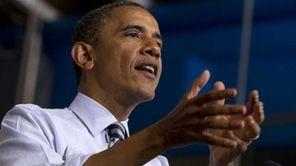 President Barack Obama gestures while speaking at Honeywell