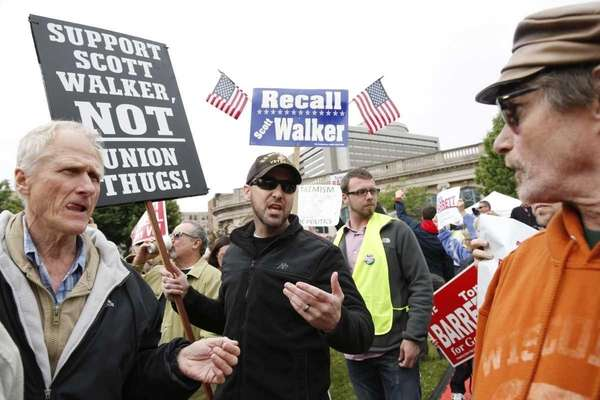 A supporter of Wisconsin Gov. Scott Walker, right,