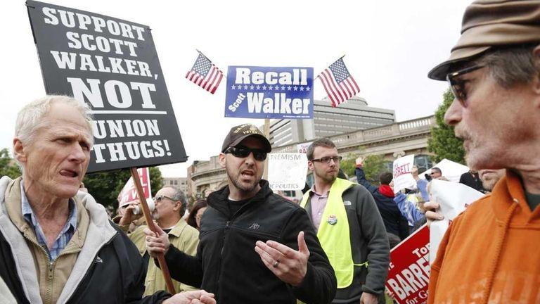 A supporter of Wisconsin Gov. Scott Walker, right,