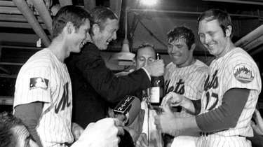 New York City Mayor John Lindsay celebrates with