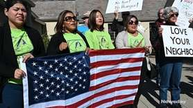Immigration advocates spoke Tuesday in Wyandanch, denouncing a