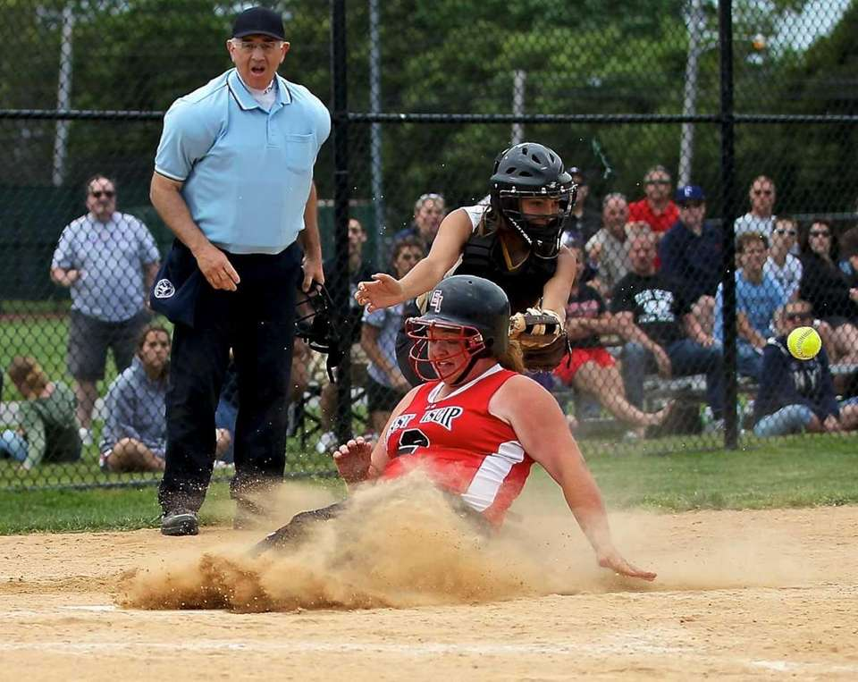 East Islip's Shelby Haywood slides safely into home