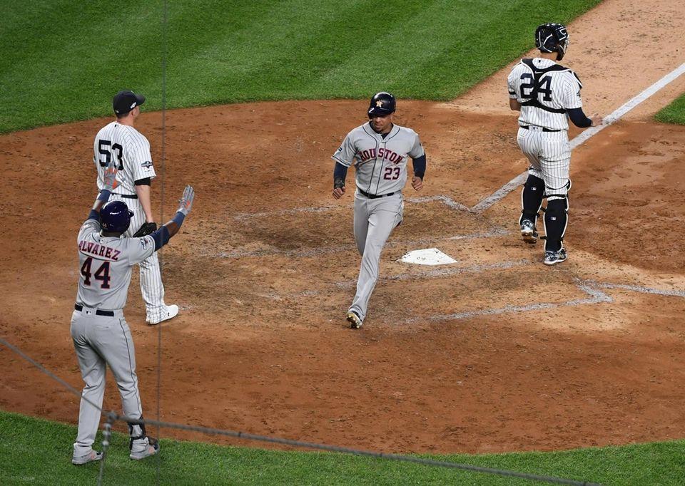 Houston Astros left fielder Michael Brantley (23) scores